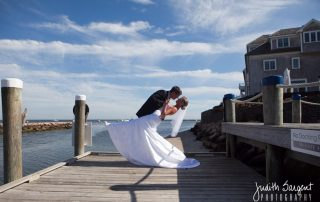 bride and groom dip on the docks